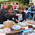 An image of people selling baked goods